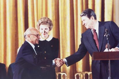 Milton Friedman congratulated by President Ronald Reagan. © 2008 Free To Choose Media, courtesy of the Power of Choice press kit