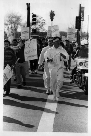Workers from USM, Inc.—largely Korean immigrants—march with other immigrant workers to protest wage theft. © David Bacon